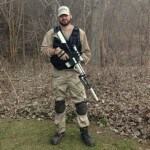 Our airsoft expert Zac with his airsoft gun and gear at Flagswipe Paintball just outside of London, Ontario, Canada.