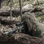 Steven in his ghillie suit playing airsoft in Canada