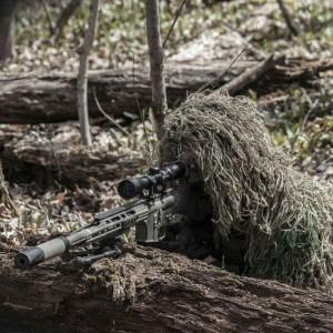 Airsoft sniper lining up his shot