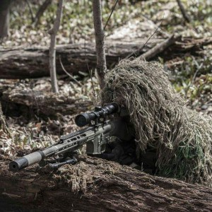 Airsoft sniper lining up his shot